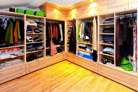 closets: Big built in wardrobe room with open shelves