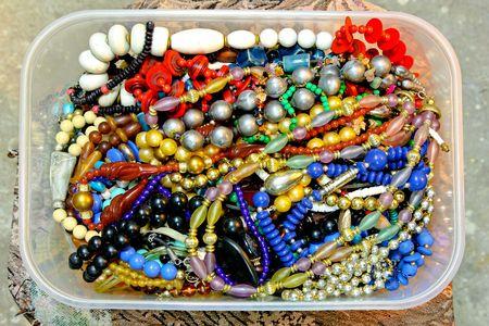 Plastic transparent box full of retro jewelry Stock Photo - 7359546
