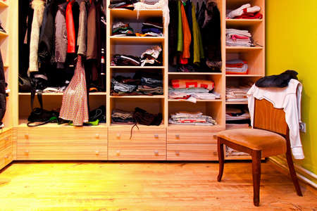 clothes closet: Corner of built in wardrobe with open shelves