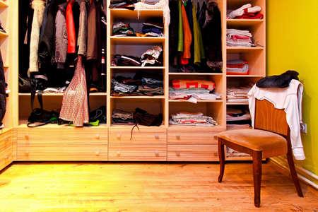 Corner of built in wardrobe with open shelves photo