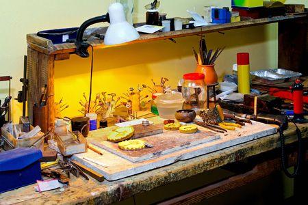 craftsmanship: Work table in the small craftsmanship studio Stock Photo