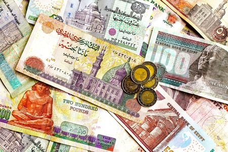 arabic currency: Big bunch of colorful Egyptian banknotes and coins