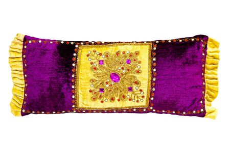 Purple pillow with gold and jewels ornaments photo