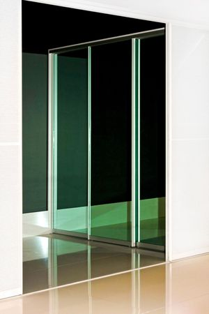 Mirrored wardrobe sliding door with reflection of the background photo