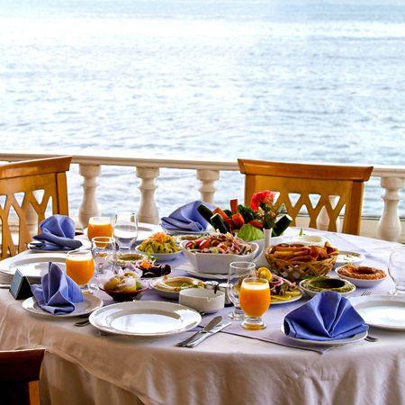 Elegant set up table with tasty food photo