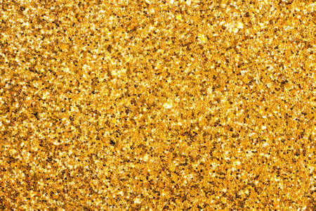 Detailed texture of glittering golden dust surface