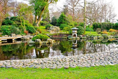 Blissful Japanese garden with pebble path and lake photo