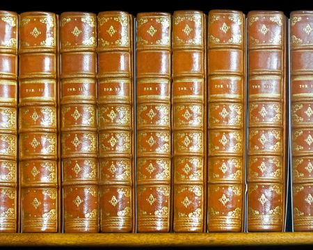 volumes: Very old books with golden cover decor