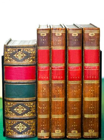volumes: Very old medieval books at library shelf