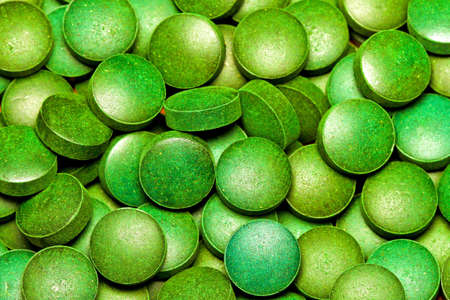 Bunch of natural organic green algae tablets Stock Photo