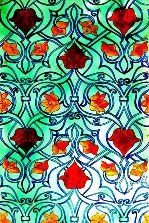 Old green stained glass with floral pattern photo