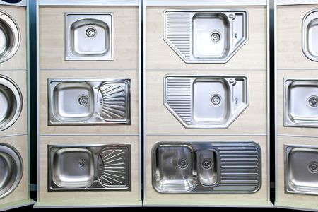 Display of stainless steel kitchen sinks samples photo