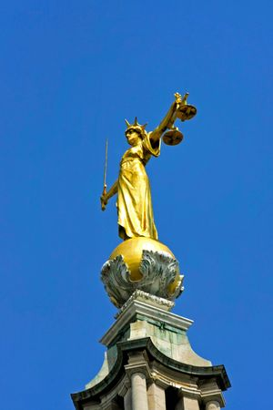 Lady justice statue at Old Bailey in London photo
