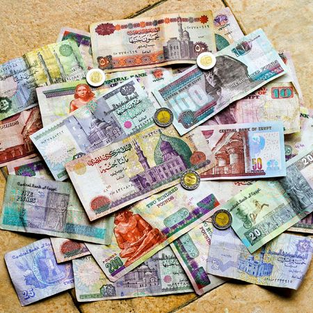 Big pile of colorful Egyptian pounds banknote photo