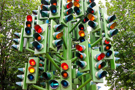 traffic control: Lot of traffic lights at big pole