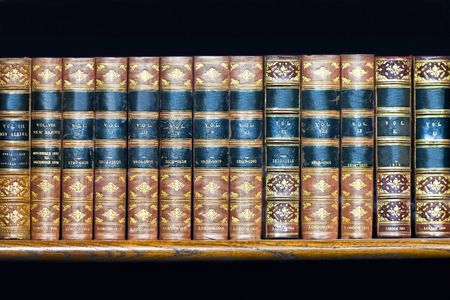 book racks: Large volume of old books at rack Stock Photo