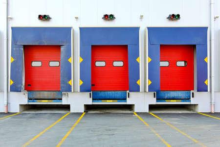 Loading dock cargo doors at big warehouse photo