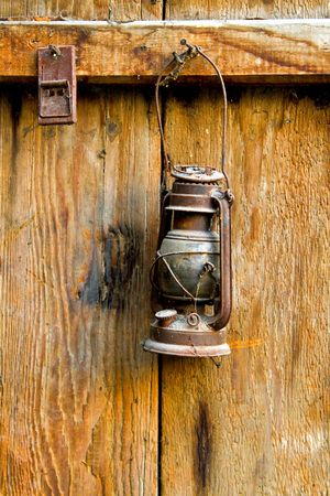 oil lamp: Very old and rusty brown oil lamp Stock Photo