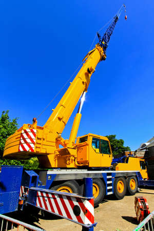 Big and yellow construction crane for heavy lifting photo