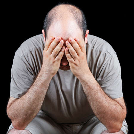 Devastated man worrying about hair loss problem photo