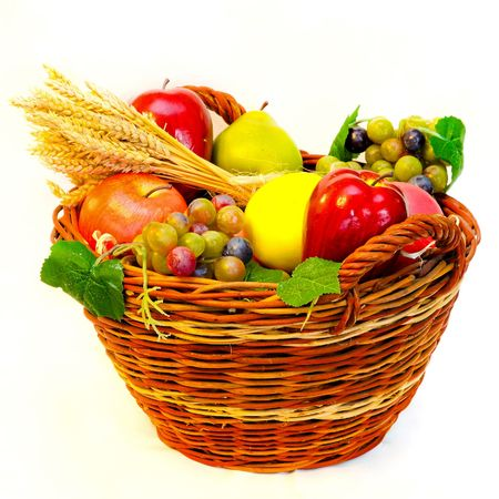 Rattan basket full of fresh organic fruits Stock Photo - 7844743