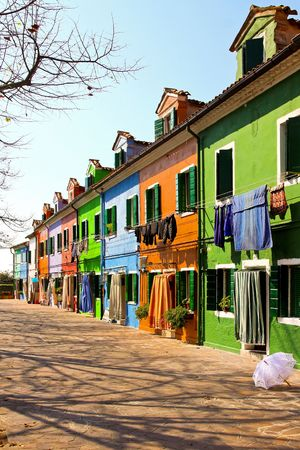 burano: Small Burano island street with colorful buildings Stock Photo