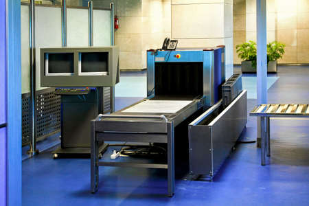 security search: Airport security check with scanner and detector