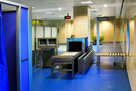 Airport security screening with X ray metal detector Stock Photo