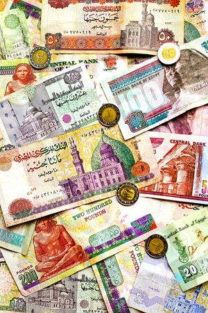 Big bunch of colorful Egyptian banknotes and coins photo