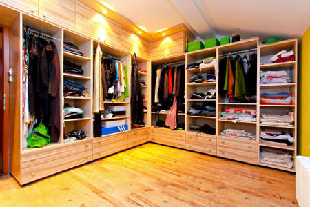 closet: Big built in wardrobe room with open shelves