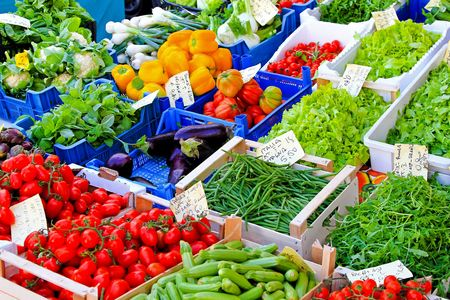 Bunch of organic vegetables sold on market stall  photo