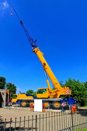 mobile crane: Big and yellow construction crane for heavy lifting  Stock Photo
