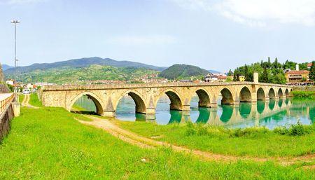 Panorama of Visegrad bridge at Drina river   photo