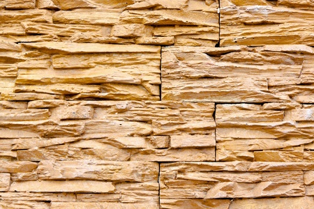Background image of wall made of natural stone tiles  photo