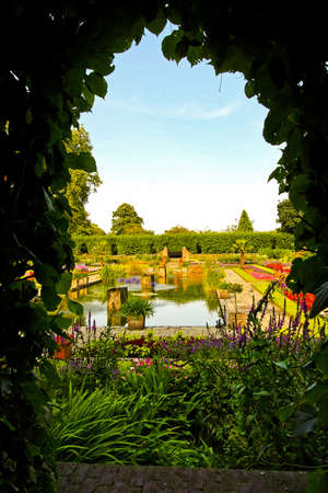 secrets: Secret passage in royal park with view to the garden  Stock Photo