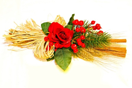 Christmas decor arrangement with red berries and wheat photo