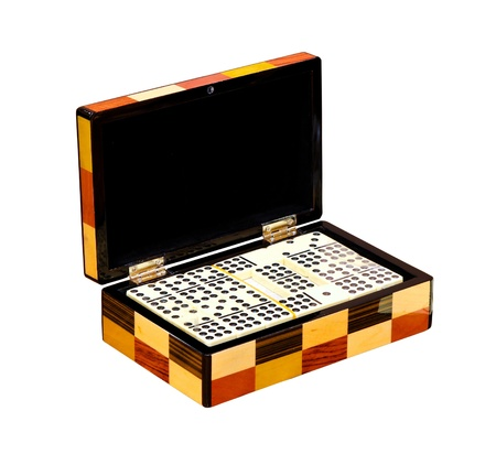 Dominos in wooden box isolated  photo