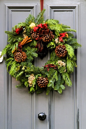 Wreath decoration at door for Christmas holiday  Stock Photo