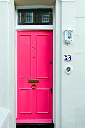 Vivid pink colour door at girls house  photo
