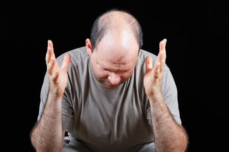 devastated: Devastated man worrying about hair loss problem  Stock Photo