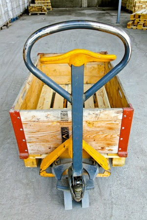 Hand powered pallet jack handle control in warehouse  Stock Photo - 8474871