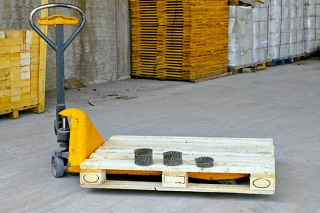 Hand powered pallet jack in wooden warehouse  Stock Photo - 8474851