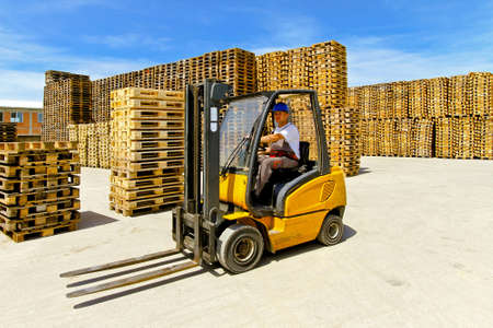 forklift driver: Forklift operator in pallet warehouse on the open  Stock Photo