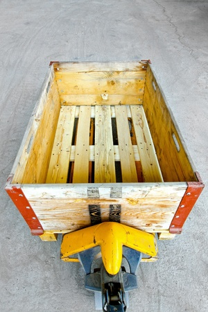 euro pallet: Hand powered pallet jack with wooden box  Stock Photo
