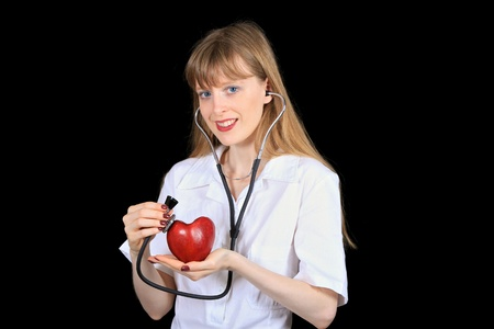 Young cardiologist holding red heart in hand photo