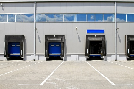 Three cargo door ramp at warehouse building  photo