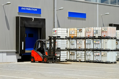 Forklift vehicle in front of cargo doors at distribution warehouse Stock Photo - 8524756