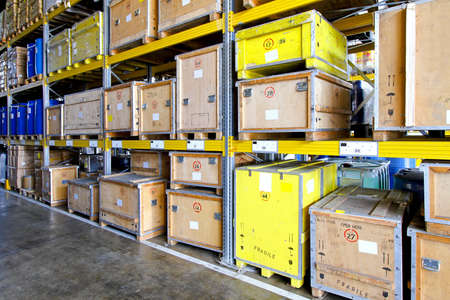 crate: Rugged crates at shelves in museum warehouse  Stock Photo