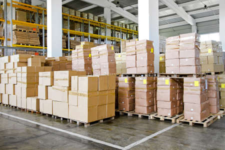 warehouse equipment: Big pile of boxes in distribution warehouse
