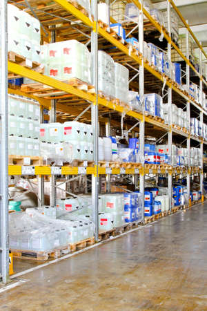 Storage rack in warehouse with chemical liquids  photo